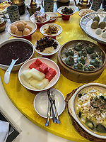 Yangzhou, Jiangsu, China.  Table Setting for Breakfast, Ye Chun Garden Tea House.  Jade Buns (green), shrimp, noodles, mushrooms, crab