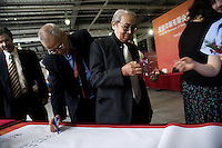 """Visiting dignitaries sign a banner congratulating the Amity Printing Company on the opening of its new press facility in Nanjing, China...On May 18, 2008, the Amity Printing Company in Nanjing, Jiangsu Province, China, inaugurated its new printing facility in southern Nanjing.  The facility doubles the printing capacity of the company, now up to 12 million Bibles produced in a year, making Amity Printing Company the largest producer of Bibles in the world.  The company, in cooperation with the international organization the United Bible Societies, produces Bibles for both domestic Chinese use and international distribution.  The company's Bibles are printed in Chinese and many other languages.  Within China, the Bibles are distributed both to registered and unregistered Christians who worship in illegal """"house churches."""""""