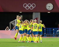 YOKOHAMA, JAPAN - AUGUST 6: Stina Blackstenius #11 of Sweden celebrates her goal with teammates during a game between Canada and Sweden at International Stadium Yokohama on August 6, 2021 in Yokohama, Japan.