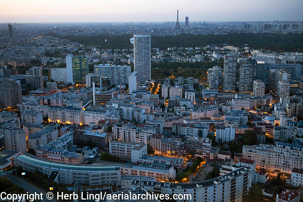 aerial view of La Defense business district toward the Eiffel Tower, Paris, France at night