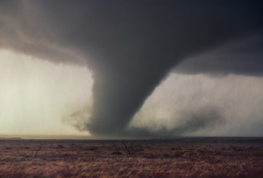 A strong tornado rips across the mesquite covered ranch-lands of northwest Texas in April.