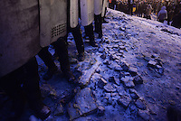 A deployment of riot poice face the barricades under the snowduring the protest against new draconian law to ban protestsacross the country.  Kiev. Ukraine