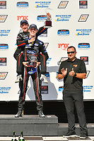 #15 Multimatic Motorsports Ford Mustang GT4, GS: Austin Cindric, Sebastian Priaulx celebrate the win on the podium