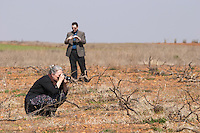 Carla Capalbo, journalist, photographing a prieto picudo vine, with Quentin Sadler planted ca 1920 Bodegas Margon , DO Tierra de Leon , Pajares de los Oteros spain castile and leon