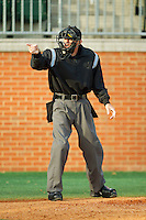 Home plate umpire Todd Drake makes a strike call during the game between the Tennessee Tech Golden Eagles and the Charlotte 49ers at Robert and Mariam Hayes Stadium on March 8, 2011 in Charlotte, North Carolina.  Photo by Brian Westerholt / Four Seam Images