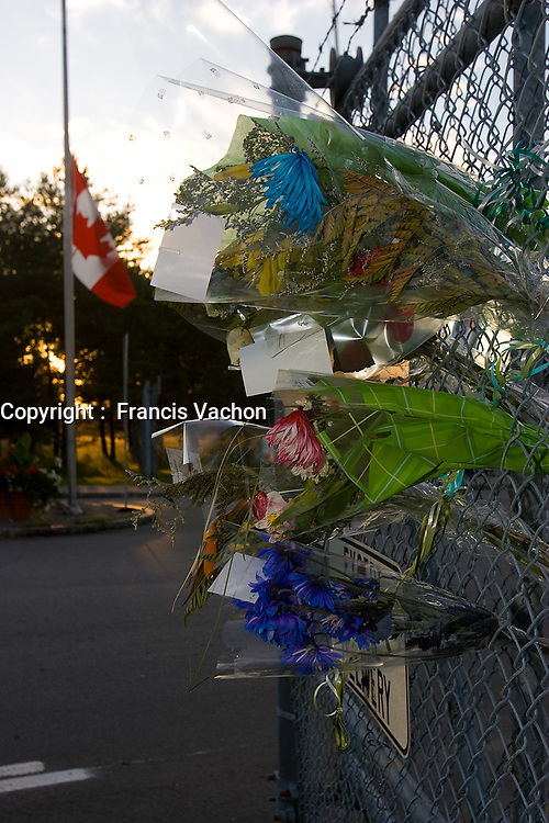 Valcartier, August 22, 2007 - Flowers meant for Simon Longtin, recently killed in line of duty in Afghanistan, where still on the Canadian Force Base Valcartier fence as the news of the death of two other Valcartier soldiers was announced August 22, 2007.