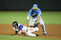 Eddy Alvarez (1) of the Winston-Salem Dash is tagged out by Myrtle Beach Pelicans shortstop Carlos Penalver (1) after getting pick-off of first base at BB&T Ballpark on August 20, 2015 in Winston-Salem, North Carolina.  The Dash defeated the Pelicans 5-4 on a walk-off wild pitch in the bottom of the 9th inning.  (Brian Westerholt/Four Seam Images)