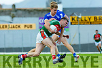 Kerry team mates Gavin Crowley Templenoe tackles Kevin McCarthy  Kilcummin during the relegation play off final in Fitzgerald Stadium on Sunday