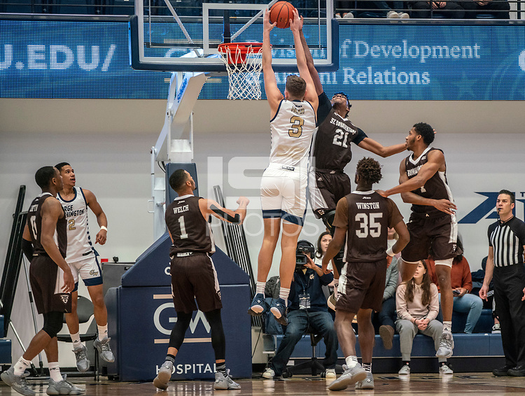 WASHINGTON, DC - JANUARY 5: Osun Osunniyi #21 of St. Bonaventure defends a a shot by Chase Paar #3 of George Washington during a game between St. Bonaventure University and George Washington University at Charles E Smith Center on January 5, 2020 in Washington, DC.