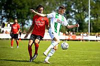 LEEK - Voetbal, Pelikaan S - FC Groningen , voorbereiding seizoen 2021-2022, oefenduel, 03-07-2021,  Pelikaan S speler Curly Selassa verdedigt FC Groningen speler Tika de Jonge