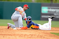 Houston Astros outfielder George Springer #75 steals second as Daniel Descalso #33 attempts to apply the tag during a Spring Training game against the St. Louis Cardinals at Osceola County Stadium on March 1, 2013 in Kissimmee, Florida.  The game ended in a tie at 8-8.  (Mike Janes/Four Seam Images)