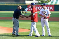 Buffalo Bisons pitcher Raul Valdes (36) is presented he Jimmy Griffin Hometown Hero Award during a ceremony as Ryan Schimpf (27) looks on before a game against the Pawtucket Red Sox on August 26, 2014 at Coca-Cola Field in Buffalo, New  York.  Pawtucket defeated Buffalo 9-3.  (Mike Janes/Four Seam Images)
