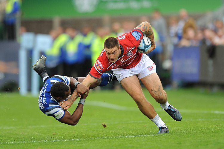 Matt Banahan of Gloucester Rugby hands off Semesa Rokoduguni of Bath Rugby in dramatic fashion during the Gallagher Premiership Rugby match between Bath Rugby and Gloucester Rugby at The Recreation Ground on Saturday 8th September 2018 (Photo by Rob Munro/Stewart Communications)