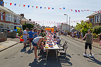 Pictured: Adults and young children Fresh enjoy themselves on the table at a street party in Cardiff. Saturday 19 May 2018<br /> Re: Prince Harry and Meghan Markle Royal Wedding Street Party at Avondale Crescent in Cardiff, Wales, UK.