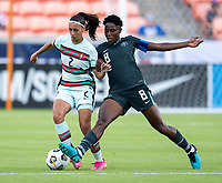 HOUSTON, TX - JUNE 13: Jessica Silva #10 of Portugal is defended by Asisat Oshoala #8 of Nigeria during a game between Nigeria and Portugal at BBVA Stadium on June 13, 2021 in Houston, Texas.