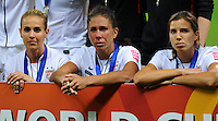 Heather Mitts (l), Shannon Boxx (C) and Tobin Heath of team USA react during the FIFA Women's World Cup Final USA against Japan at the FIFA Stadium in Frankfurt, Germany on July 17th, 2011.