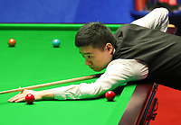 19th April 2021; Crucible Theatre, Sheffield, England; Betfred Snooker World Championships; China's Ding Junhui competes during the first round match with Englands Stuart Bingham