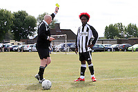 An FC Metwin player is shown a yellow card by the referee during a Hackney & Leyton Sunday League game at Hackney Marshes - 06/09/09 - MANDATORY CREDIT: Gavin Ellis/TGSPHOTO - Self billing applies where appropriate - Tel: 0845 094 6026