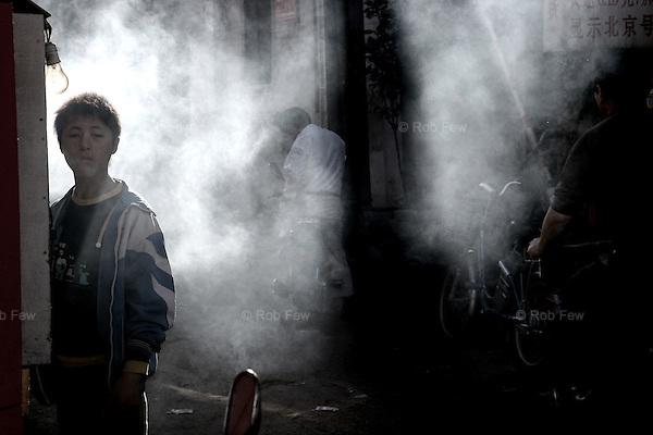Smoke from hutong street food.