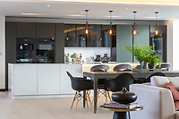 BNPS.co.uk (01202) 558833<br /> Pic: Savills/BNPS<br /> <br /> Kitchen, dining and living room<br /> <br /> A striking high-tech eco home that would not look out of place in a Bond film is on the market for offers over £4m.<br /> <br /> Skyfall is a luxurious house in the Berkshire countryside designed to be totally carbon free.<br /> <br /> With its luxe white interiors, minimalist decor and stunning countryside surroundings, the five-bedroom property would fit effortlessly into 007's world.<br /> <br /> But it's the eco features of the brand new house, which is just outside the village of Taplow with Huntswood Golf Course next door, that make it really stand out.
