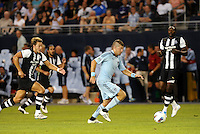 Luke Sassano Sporting KC (pale blue) gts ahead of Alan Smith Newcastle United,.. Sporting Kansas City and Newcastle United played to a 0-0 tie in an international friendly at LIVESTRONG Sporting Park, Kansas City, Kansas.