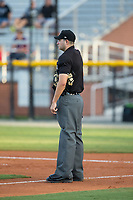 Home plate umpire Ben Fernandez between innings of the Appalachian League game between the Danville Braves and the Burlington Royals at Burlington Athletic Stadium on August 15, 2017 in Burlington, North Carolina.  The Royals defeated the Braves 6-2.  (Brian Westerholt/Four Seam Images)