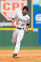 Jordan Danks (23) of the Charlotte Knights hustles towards third base against the Gwinnett Braves at Knights Stadium on July 28, 2013 in Fort Mill, South Carolina.  The Knights defeated the Braves 6-1.  (Brian Westerholt/Four Seam Images)