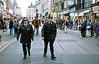 Mounted police officers on patrol accompanied by officers on foot. This image may only be used to portray the subject in a positive manner..©shoutpictures.com..john@shoutpictures.com