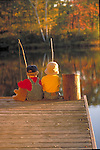 young children fishing from dock