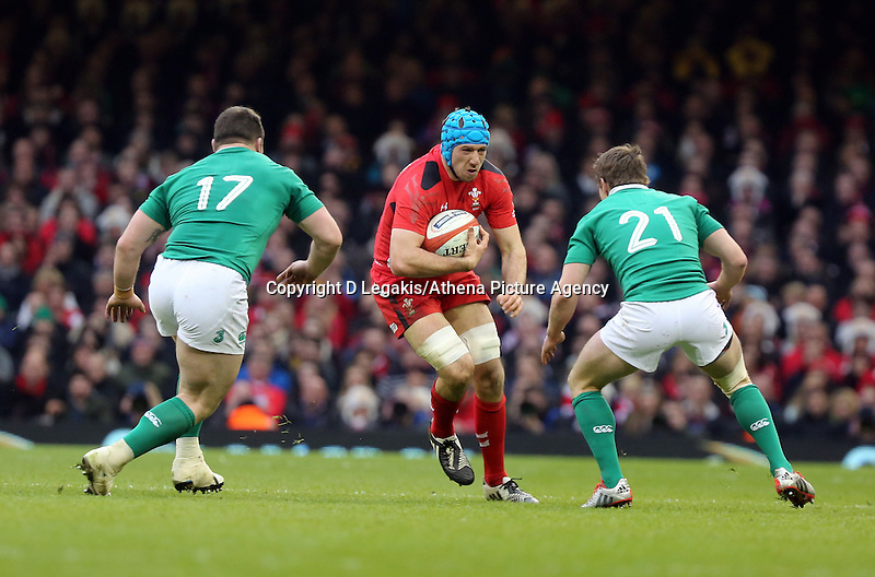 Pictured:Justin Tipuric of Wales (C) against Cian Healy (L) and Eoin Reddan of Ireland Saturday 14 March 2015<br /> Re: RBS Six Nations, Wales v Ireland at the Millennium Stadium, Cardiff, south Wales, UK.