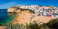 Colorful Carvoeiro village, beach, and cliffs, over the turquoise Atlantic Ocean, in the beautiful, sunny Algarve region south of Portugal, Europe