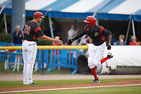 Batavia Muckdogs center fielder Thomas Jones (29) shakes hands with manager Mike Jacobs (28) after hitting a home run during a game against the Mahoning Valley Scrappers on August 29, 2017 at Dwyer Stadium in Batavia, New York.  Batavia defeated Mahoning Valley 2-0.  (Mike Janes/Four Seam Images)