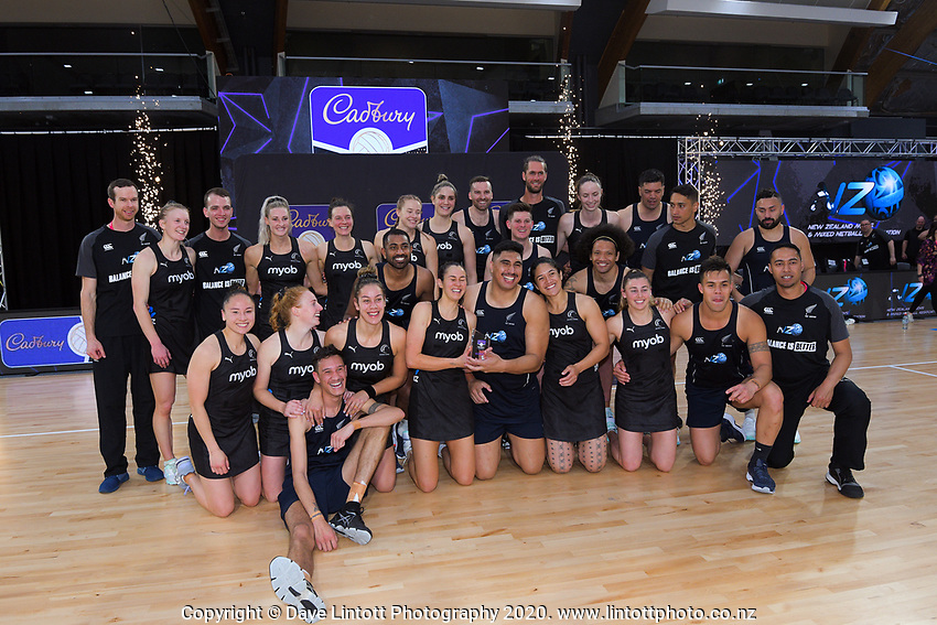 The Silver Ferns and NZ Men pose for a group photo after the Cadbury Netball Series final between NZ Silver Ferns and NZ Men at the Fly Palmy Arena in Palmerston North, New Zealand on Saturday, 24 October 2020. Photo: Dave Lintott / lintottphoto.co.nz