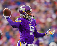 19 October 2014: Minnesota Vikings quarterback Teddy Bridgewater looks downfield for an open receiver during the first quarter against the Buffalo Bills at Ralph Wilson Stadium in Orchard Park, NY. The Bills defeated the Vikings 17-16 in a dramatic, last minute, comeback touchdown drive. Mandatory Credit: Ed Wolfstein Photo *** RAW (NEF) Image File Available ***