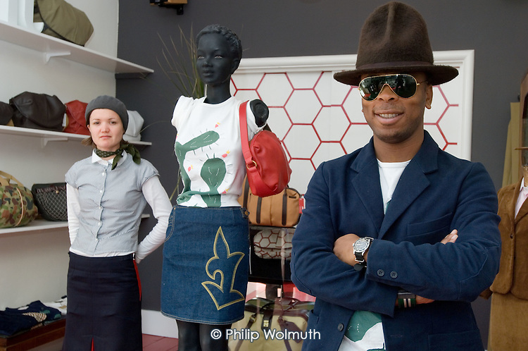 Designer Bayode Oduwole and business partner Claire in their shop, Pokit, in North Paddington, London.