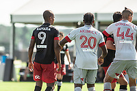 LAKE BUENA VISTA, FL - JULY 13: Ola Kamara #9 of DC United and Ayo Akinola #20 of Toronto FC battle for the ball during a game between D.C. United and Toronto FC at Wide World of Sports on July 13, 2020 in Lake Buena Vista, Florida.