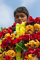 India, Rishikesh.  Boy with Flowers for Sale as Offerings.
