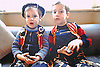 2 young boys (brothers) dressed in colourful Cowboy clothes.<br />