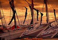 Traditional schooners at sunset Paotere Harbor Ujung Pandang Sulawesi Indonesia.