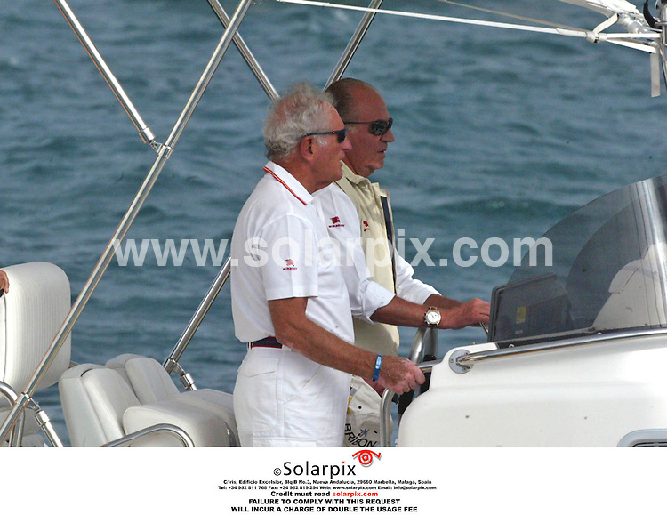 ALL ROUND EXCLUSIVE PICTURES BY SOLARPIX.COM. .***NOT FOR PUBLICATION IN SPAIN***.King Juan Carlos of Spain competing in a sailing regatta in Ibiza on 22.0906. JOB REF:2834 - MAD..MUST CREDIT SOLARPIX.COM OR DOUBLE FEE WILL BE CHARGED.....