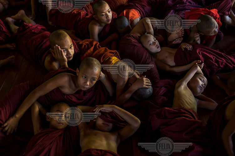 Buddhist novice monks watch a cartoon called Moana as part of an English lesson at Shwe Gu Buddhist monastery. Shwe Gu monastery and philanthrophic orphanage is home to around 85 Buddhist novices and monks, some of them orphans, others from poor families.