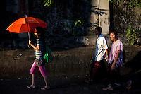 People walk through central Yangon.