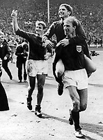 30 July 1966 Wembley Stadium, England. 1966 World Cup Final, Germany versus England.Jack Charlton carries Alan Ball as Roger Hunt (l) follows up the rear after beating Germany 4-2 after extra time is played.