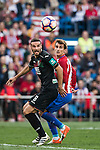 David Rodriguez Lomban of Granada CF competes for the ball with Antoine Griezmann of Atletico de Madrid during their La Liga match between Atletico de Madrid and Granada CF at the Vicente Calderon Stadium on 15 October 2016 in Madrid, Spain. Photo by Diego Gonzalez Souto / Power Sport Images