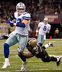 December 2009: New Orleans Saints linebacker Jonathan Vilma (51) tackles Dallas Cowboys tight end Jason Witten (82) during an NFL football game at the Louisiana Superdome in New Orleans.  The Cowboys defeated the Saints 24-17.