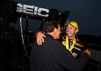 Aug 17, 2014; Brainerd, MN, USA; NHRA top fuel dragster driver Morgan Lucas (right) celebrates with his father Forrest Lucas after winning the Lucas Oil Nationals at Brainerd International Raceway. Mandatory Credit: Mark J. Rebilas-