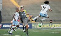 Chicago midfielder, Karen Carney (14) goes airborne to try and block a pass by Philadelphia captain, Lori Lindsey (6).  The Philadelphia Independence shut out the Chicago Red Stars, 3-0 on two goals from Amy Rodriguez and one from Caroline Seger at John A Farrell Stadium in West Chester, Pennsylvania.