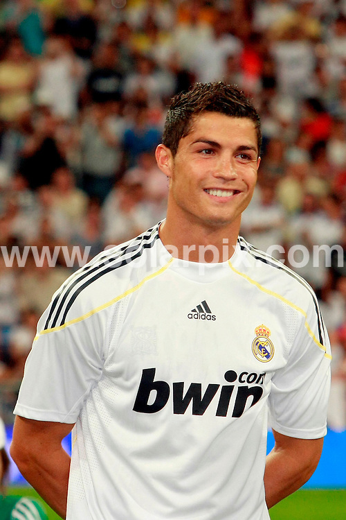**ALL ROUND PICTURES FROM SOLARPIX.COM**.**SYNDICATION RIGHTS FOR UK, ASIA, AUSTRALIA, CANADA, DUBAI, GREECE, NEW ZEALAND, RUSSIA, SOUTH AFRICA, SOUTH AMERICA, AND USA**.Cristiano Ronaldo scored his first goal for Real Madrid last night at the Peace Cup game between Real Madrid and Quito in Bernabeu Stadium, Madrid, Spain. 28 July 2009..This pic: Cristiano Ronaldo..JOB REF: 9629 SPA     DATE: 28_07_2009.**MUST CREDIT SOLARPIX.COM OR DOUBLE FEE WILL BE CHARGED**.**MUST NOTIFY SOLARPIX OF ONLINE USAGE**.**CALL US ON: +34 952 811 768 or LOW RATE FROM UK 0844 617 7637**