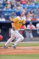 Beer City Tourists left fielder Eric Toole (14) lays down a bunt during a game against the Lakewood BlueClaws at McCormick Field on June 1, 2017 in Asheville, North Carolina. The Tourists defeated the BlueClaws 8-5. (Tony Farlow/Four Seam Images)