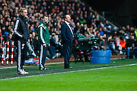 Swansea, UK. Thursday 20 February 2014<br /> Pictured: Garry Monk, Manager of Swansea City and Rafa Benitez, Manager of Napoli on the touchline during the game<br /> Re: UEFA Europa League, Swansea City FC v SSC Napoli at the Liberty Stadium, south Wales, UK
